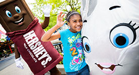 Girl and Hershey's Kiss character playing at Hersheypark