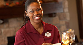 Woman server working at Harvest