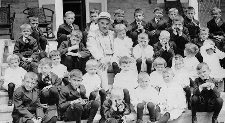 Milton Hershey and Milton Hershey School students sitting on school steps