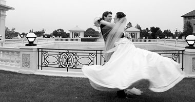 Bride & Groom twirling by The Hotel Hershey fountains