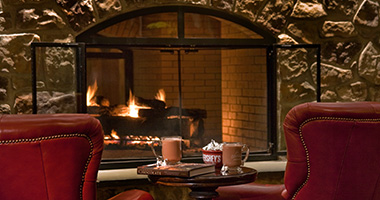 Chairs in front of the fireplace at the Lodge