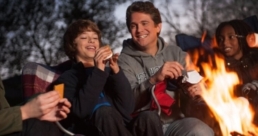 Dad and son eating smores