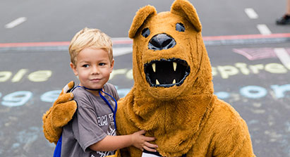 little boy and nittany lion