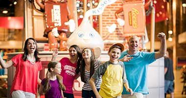 Family interacting at Hershey's Chocolate World