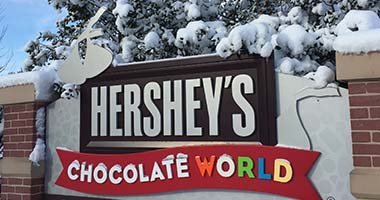 Chocolate world sign with snow