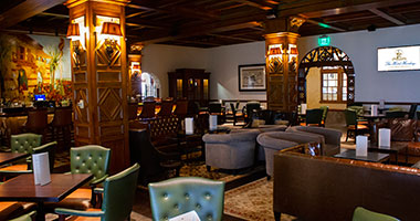 fireplace and casual couch seating inside the Iberian Lounge at The Hotel Hershey