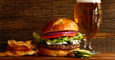 a big juicy hamburger and a beer