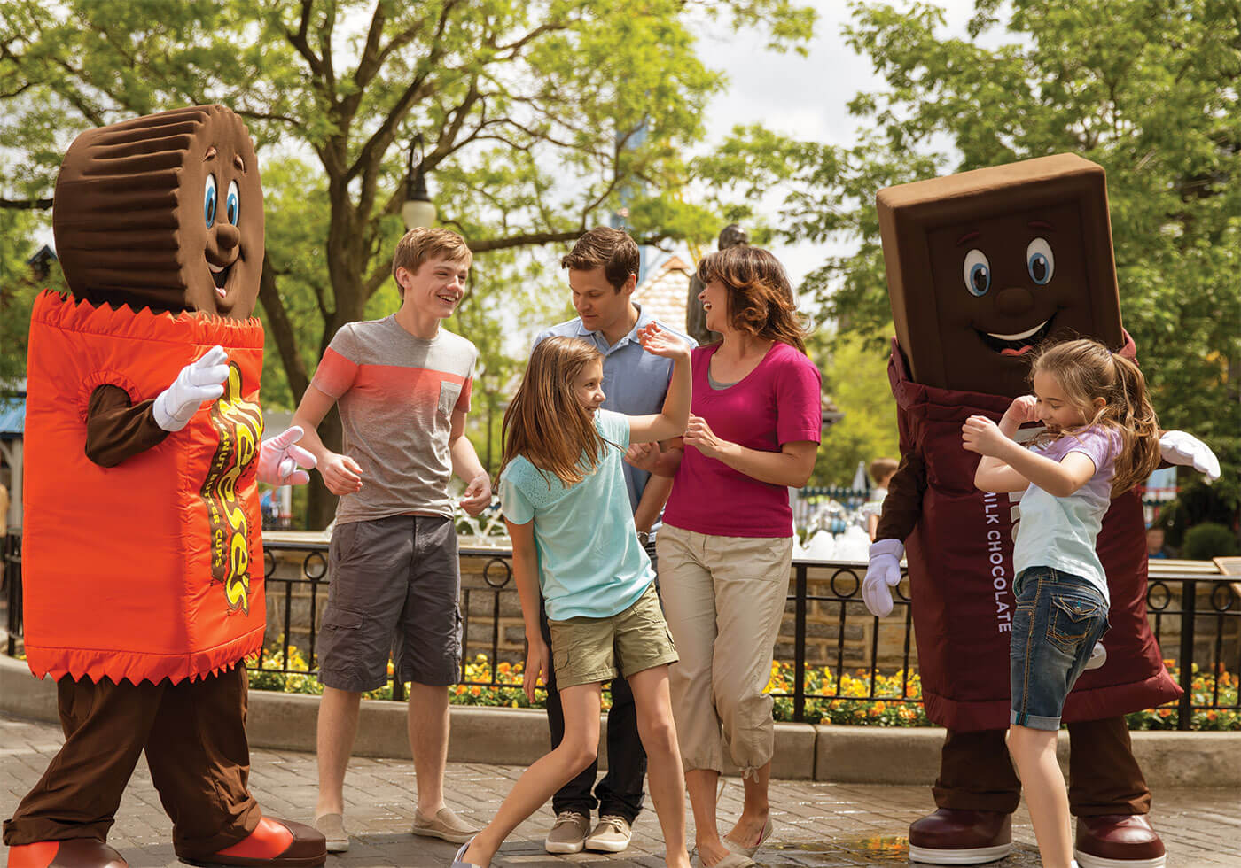 family having fun with Hershey's costume characters