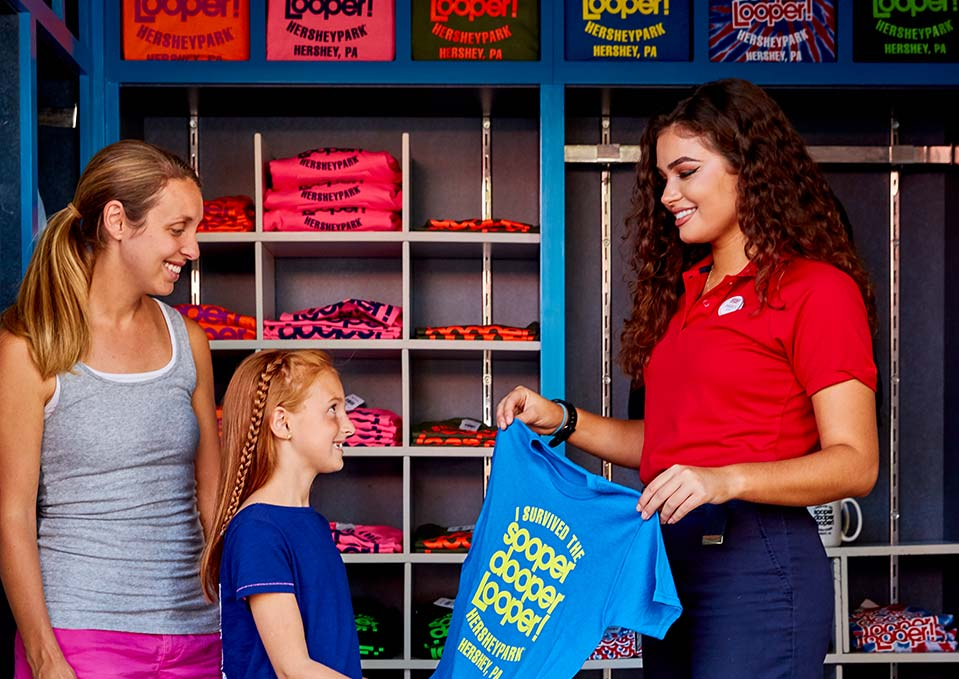 Family purchasing T-shirt at Hersheypark retail kiosk