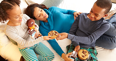 Family enjoying cookies at an Official Hersheypark Resort