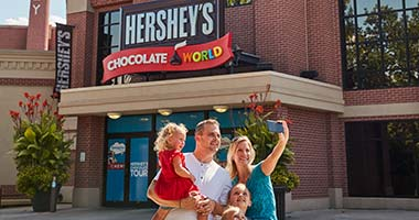 Family outside of chocolate world