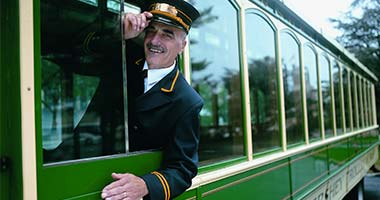 Trolley driver tipping his hat