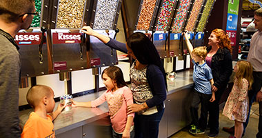 Family interacting at Hershey's Largest Candy Store